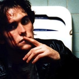 still from the film showing title character in a bathroom with blood on his face
